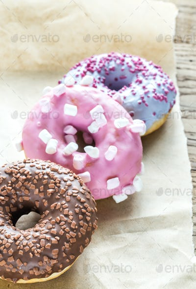 Colourful donuts on the baking paper
