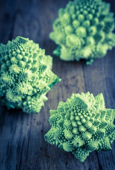 Fresh romanesco broccoli on the wooden board
