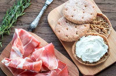 Slices of jamon and sandwich with cream cheese