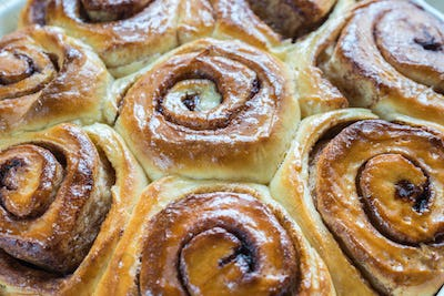 Cinnamon rolls on the wooden background