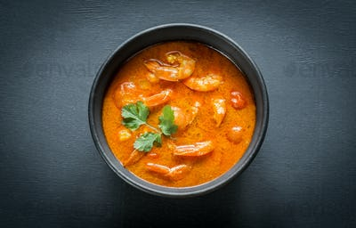 Bowl of thai yellow curry with seafood