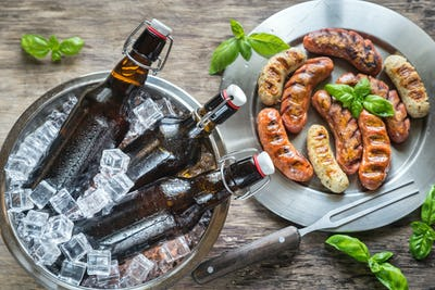 Grilled sausages with bottles of beer