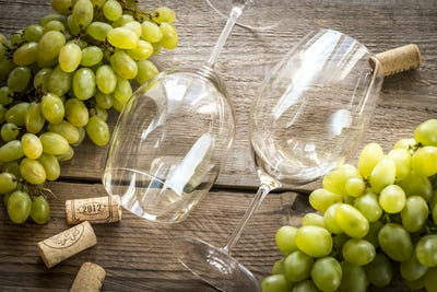 Glasses of white wine with grape: top view