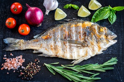 Grilled dorada fish fresh vegetables and herbs