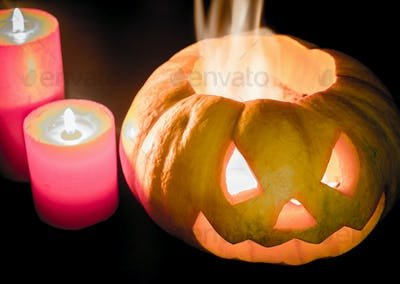 Glowing halloween pumpkin in candlelight