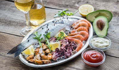 Fresh seabass with seafood on the tray