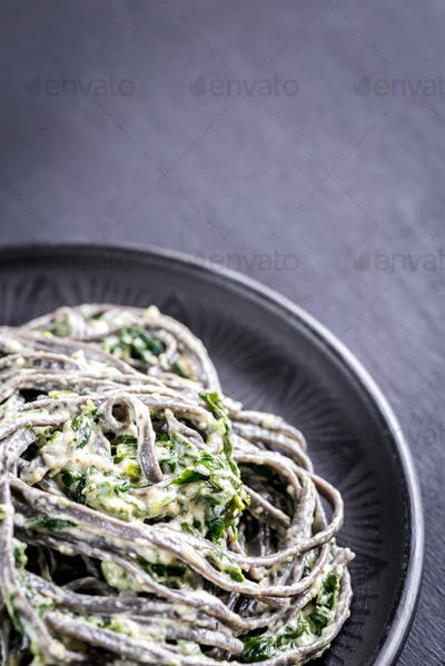 Black pasta with spinach, mascarpone and Parmesan