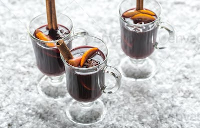 Glasses of mulled wine in snow