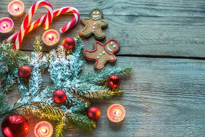 Decorated Christmas tree branch with cookies and candies