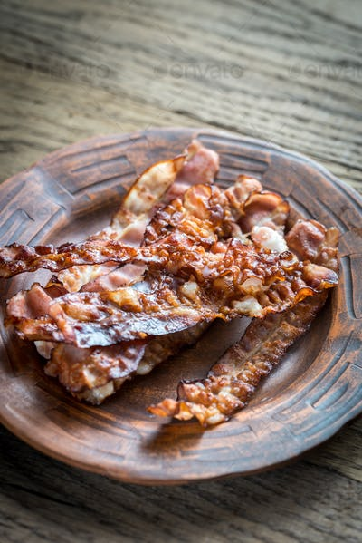 Fried bacon strips on the plate