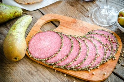 Slices of italian salami with pears