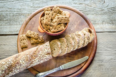 Baguette with crisps on the wooden tray