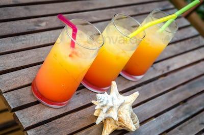 Three tequila sunrise cocktails