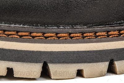 The shoe of needled strong thread, stitch of seam close-up, isol