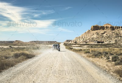 Tourist car and dirt road