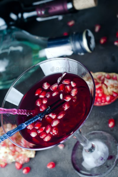 Pomegranate martini with pomegranate seeds in a glass