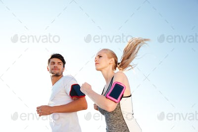 Man and woman joggers exercising outdoors