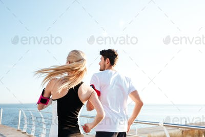 Back view of a couple exercising for marathon