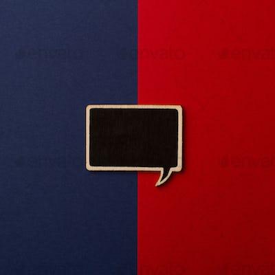 Square empty chalkboard wooden speech bubble on red and dark blu