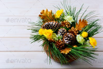 Christmas table decoration with pine branches and golden cones