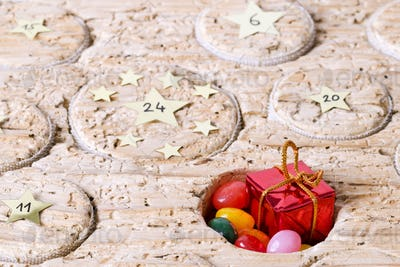 Open window of Advent calendar handmade from old timber
