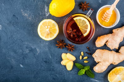 cup of tea with ginger, lemon, honey, anise, cloves and cardamom
