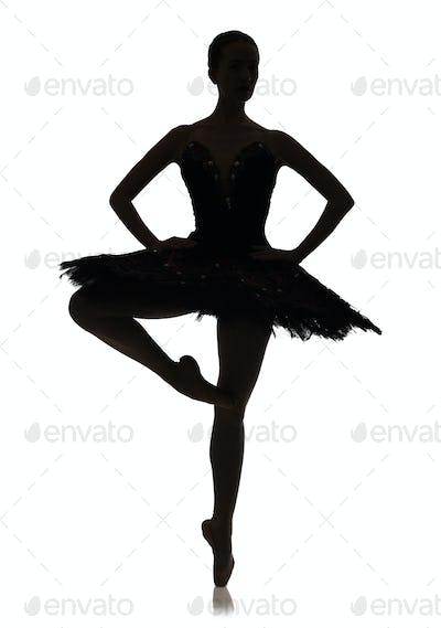 Ballerina silhouette making ballet position pirouette against white background, isolated