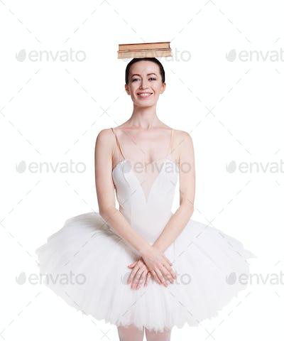 Ballerina training ballet posture isolated on white background