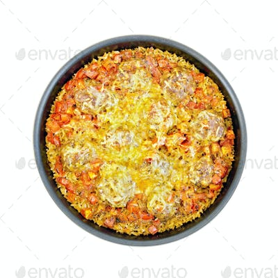 Casserole with meatballs and rice in frying pan