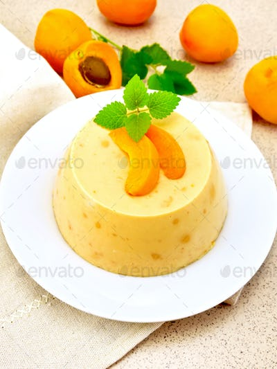 Panna cotta apricot with fruit on table