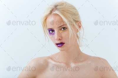 Portrait of beautiful young woman with stylish makeup