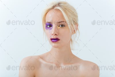 Beauty portrait of woman with blonde hair and creative makeup