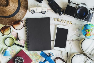 Traveler's accessories and items with black notebook and copyspace