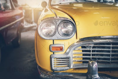 Close up headlight of yellow Retro classic car