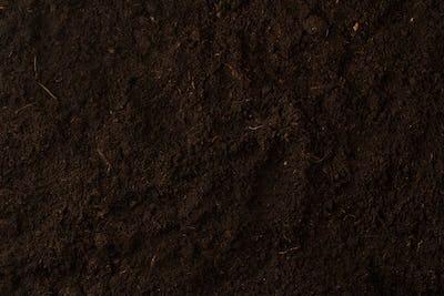 Black soil texture background top view