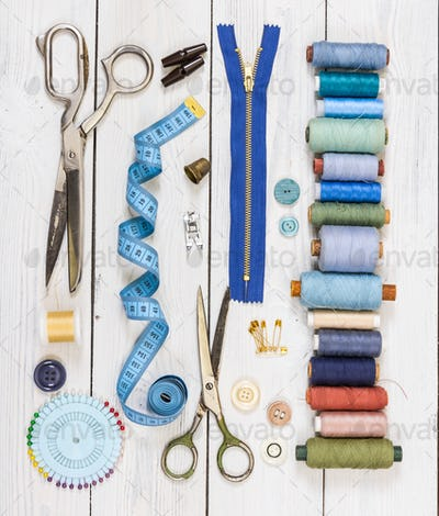 Old scissors, buttons, threads, measuring tape and sewing suppli