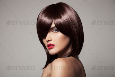 Beautiful Model With Perfect Glossy Brown Hair. Close-Up Portrait