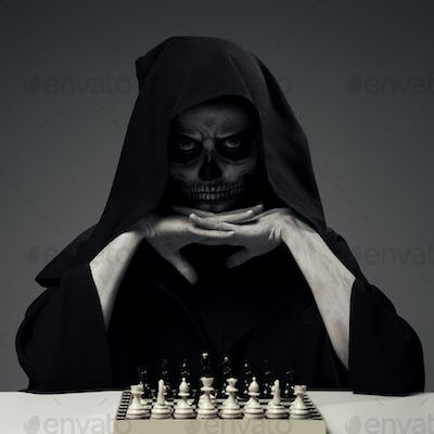 """Concept """"Playing With Death"""". Woman In Realistic Skull Makeup"""