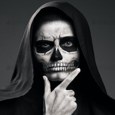 Death Ponders Supporting His Head Arm. Realistic Skull Makeup