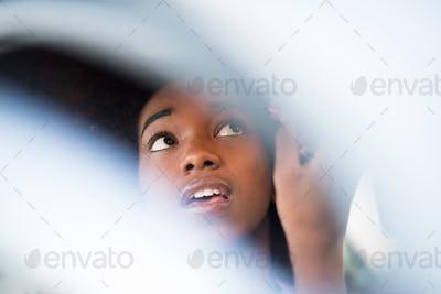 woman making makeup while driving car