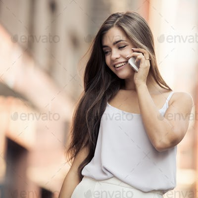 Young Beautiful Woman Talking On Mobile Phone.