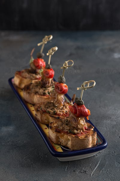 Tuna Tapenade on Lightly Toasted Baguette with pepper, onion and capers