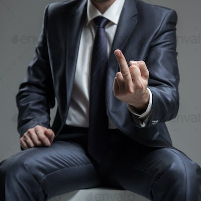 Businessman in Blue Suit Show Middle Finger or Fuck You Sign.