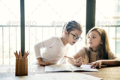 Girls Drawing Homework Study Concept