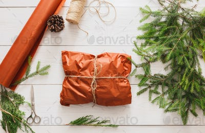 Wrapping christmas present gift on white wood background