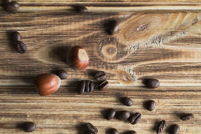 coffee beans and hazelnuts on wooden background