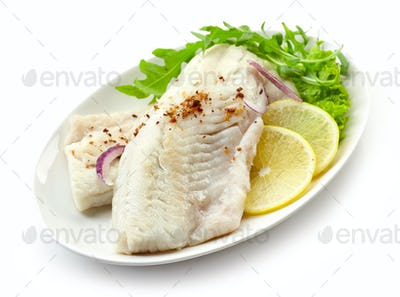 roasted perch fish fillets on white plate