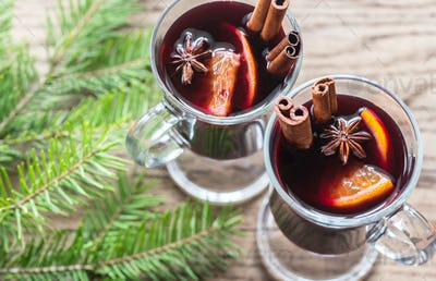 Two glasses of mulled wine with fir branch