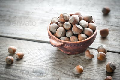Rustic bowl of hazelnuts on the wooden table