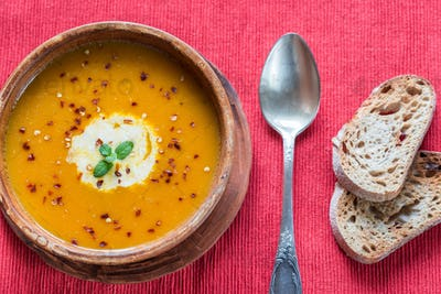 Bowl of spicy pumpkin cream soup: top view
